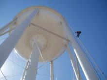 Inspector climbs 750,000 gallon water storage tower.