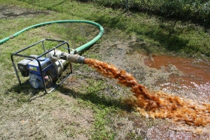 Sediment being removed from a potable water storage tank